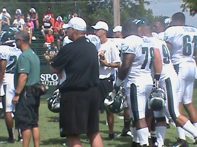 Andy Reid watching defense drills at Training Camp